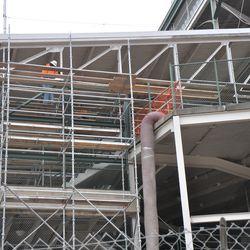 Adding scaffolding near Gate D  near Addison & Sheffield