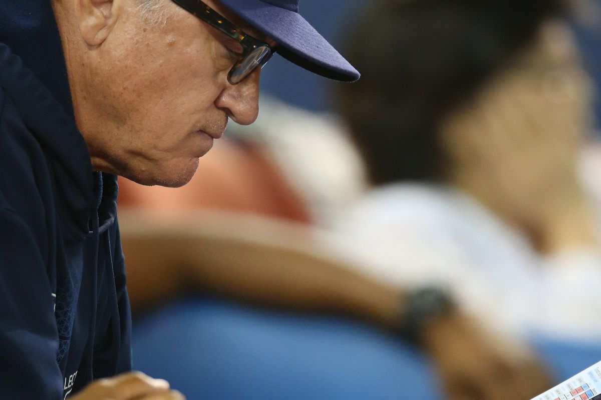 TORONTO, CANADA - AUGUST 30:  Joe Maddon #70 of the Tampa Bay Rays looks at his lineup card during MLB game action against the Toronto Blue Jays on August 30, 2012 at Rogers Centre in Toronto, Ontario, Canada. (Photo by Tom Szczerbowski/Getty Images)