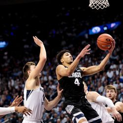 Gonzaga Bulldogs guard Ryan Woolridge (4) goes to the hoop during the game against the Brigham Young Cougars at the Marriott Center in Provo on Saturday, Feb. 22, 2020.