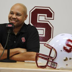 Stanford head coach David Shaw smiles during a news conference on the Stanford University campus in Palo Alto, Calif, Wednesday, Feb. 1, 2012, as he talks about new Stanford NCAA college football recruits. Stanford signed three of the top offensive lineman as well as running back Barry Sanders.