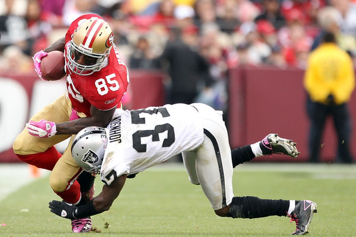 SAN FRANCISCO - OCTOBER 17:  Vernon Davis #85 of the San Francisco 49ers is tackled by Chris Johnson #37 of the Oakland Raiders at Candlestick Park on October 17 2010 in San Francisco California.  (Photo by Ezra Shaw/Getty Images)