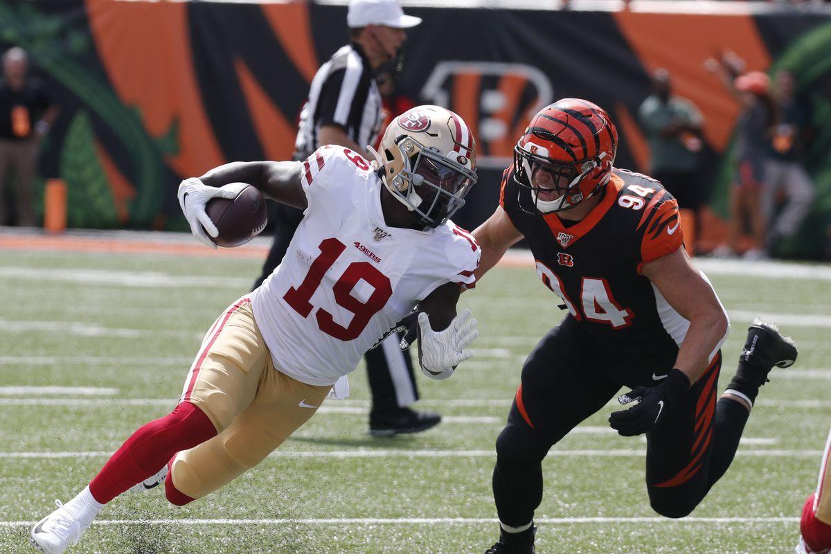 San Francisco 49ers wide receiver Deebo Samuel runs against Cincinnati Bengals defensive end Sam Hubbard during the first half at Paul Brown Stadium.