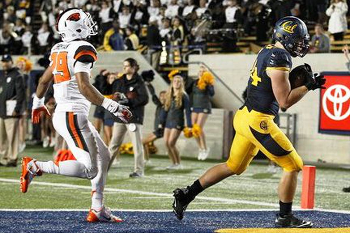 Jacob Wark, shown scoring a touchdown against Oregon St.'s Steven Christian last year, will join the Beavers for his senior season this fall.