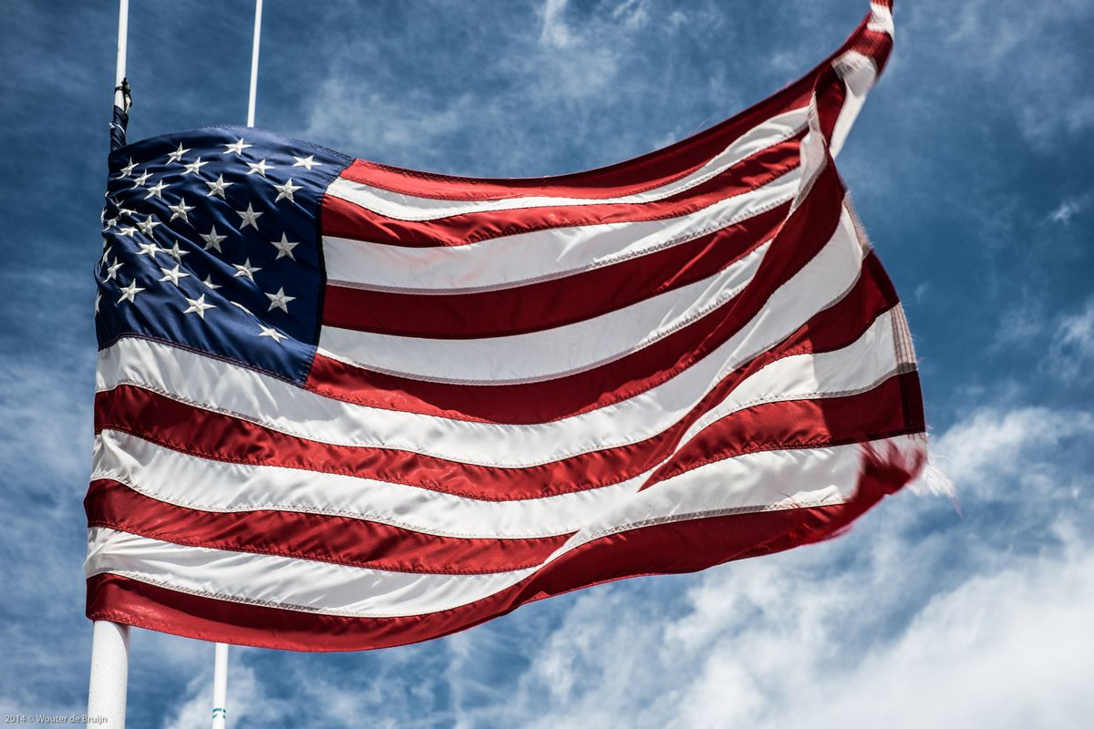 The American flag blows in the wind.