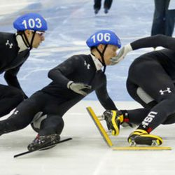Keith Carroll Jr. (106) wipes out as Ryan Pivirotto (103) and John-Henry Krueger (102) skate in the men's 1000-meters A final race during the U.S.Olympic short track speedskating trials Sunday, Dec. 17, 2017, in Kearns, Utah. (AP Photo/Rick Bowmer)