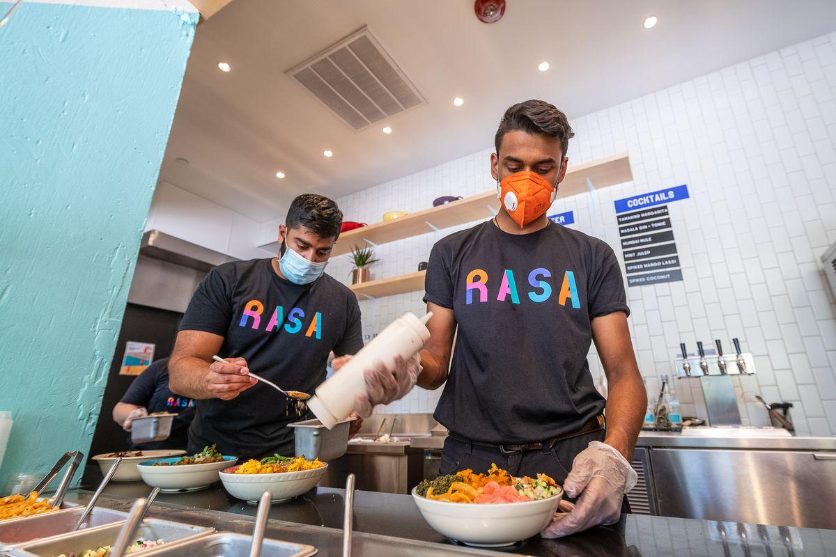 RASA partners RahulVinod, left, and Sahil Rahman prepare Indian bowls inside the new Mt. Vernon Triangle location.