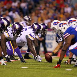 Aug 16, 2013; Orchard Park, NY, USA;  Buffalo Bills center David Snow (61) waits to snap the ball during the second half \am at Ralph Wilson Stadium.  Buffalo defeats Minnesota 20 to 16.