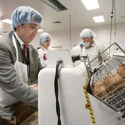 Church Service Missionary Elder Parker Hedin operates a bread slicer at the Welfare Square bakery in Salt Lake City, Tuesday, May, 31, 2016.