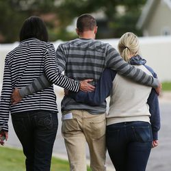 Family members leave after speaking about Russell Jacobs in East Millcreek, Friday, Oct. 30, 2015. They are Lyne Miller, a cousin to Russell Jacobs' wife, nephew Brian Stolk and niece Kallie Stolk. Jacobs died after being shot Oct. 29, 2015.