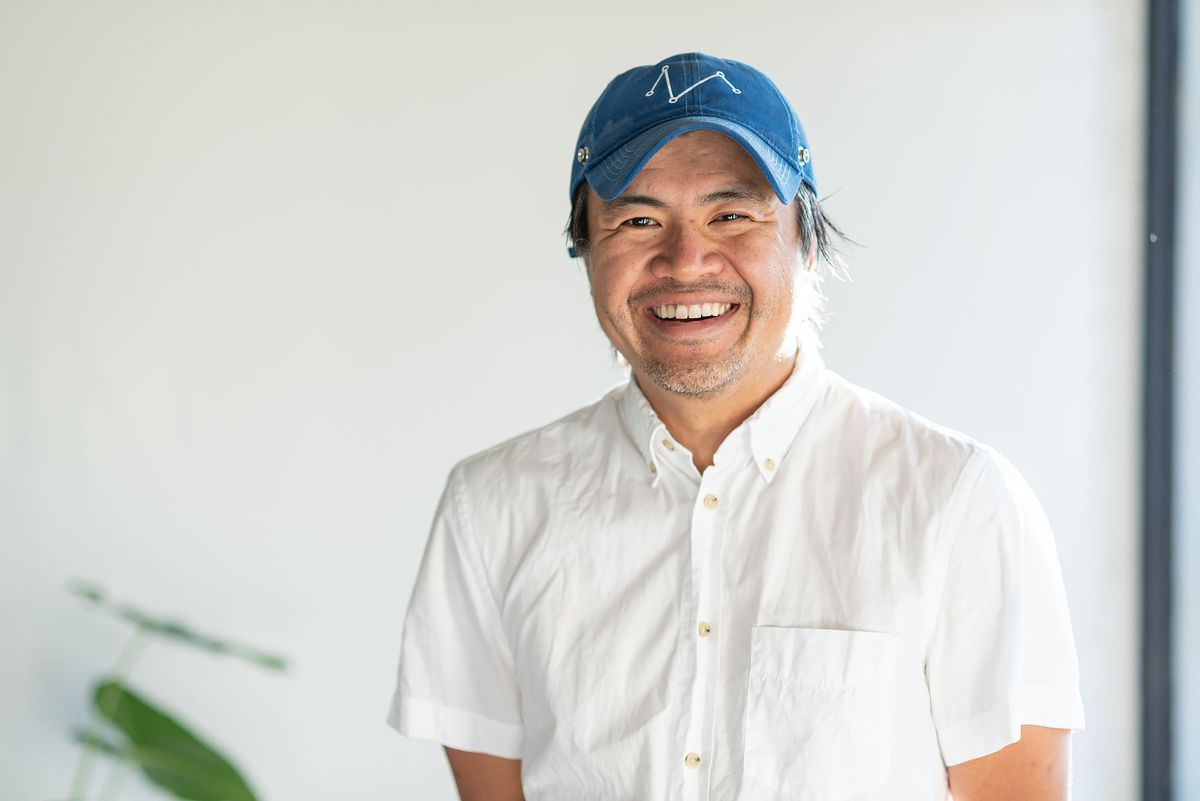 Hak Lonh, chef of Gamboge in Lincoln Heights wearing a blue hat and chef's whites.