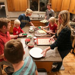 The Kirby family makes Christmas cookies during a family night at their house in Lehi on Thursday, Dec. 17, 2020.