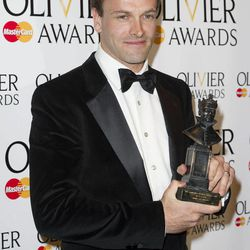 British actor, Jonny Lee Miller, poses with his award for Best Actor at the Olivier Awards at the Royal Opera House, London,  Sunday, April 15, 2012.