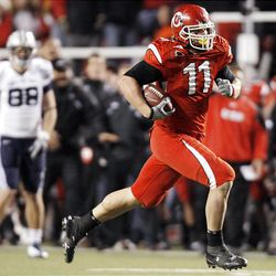 Utah defensive end Paul Kruger (11) returns an interception during the Utes' lopsided victory over BYU at Rice-Eccles Stadium.