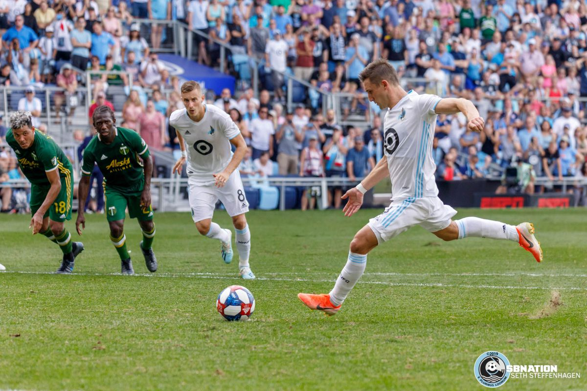 August 4, 2019 - Saint Paul, Minnesota, United States - Minnesota United midfielder Ethan Finlay (13) scores a goal off a penalty kick during the match against the Portland Timbers at Allianz Field.