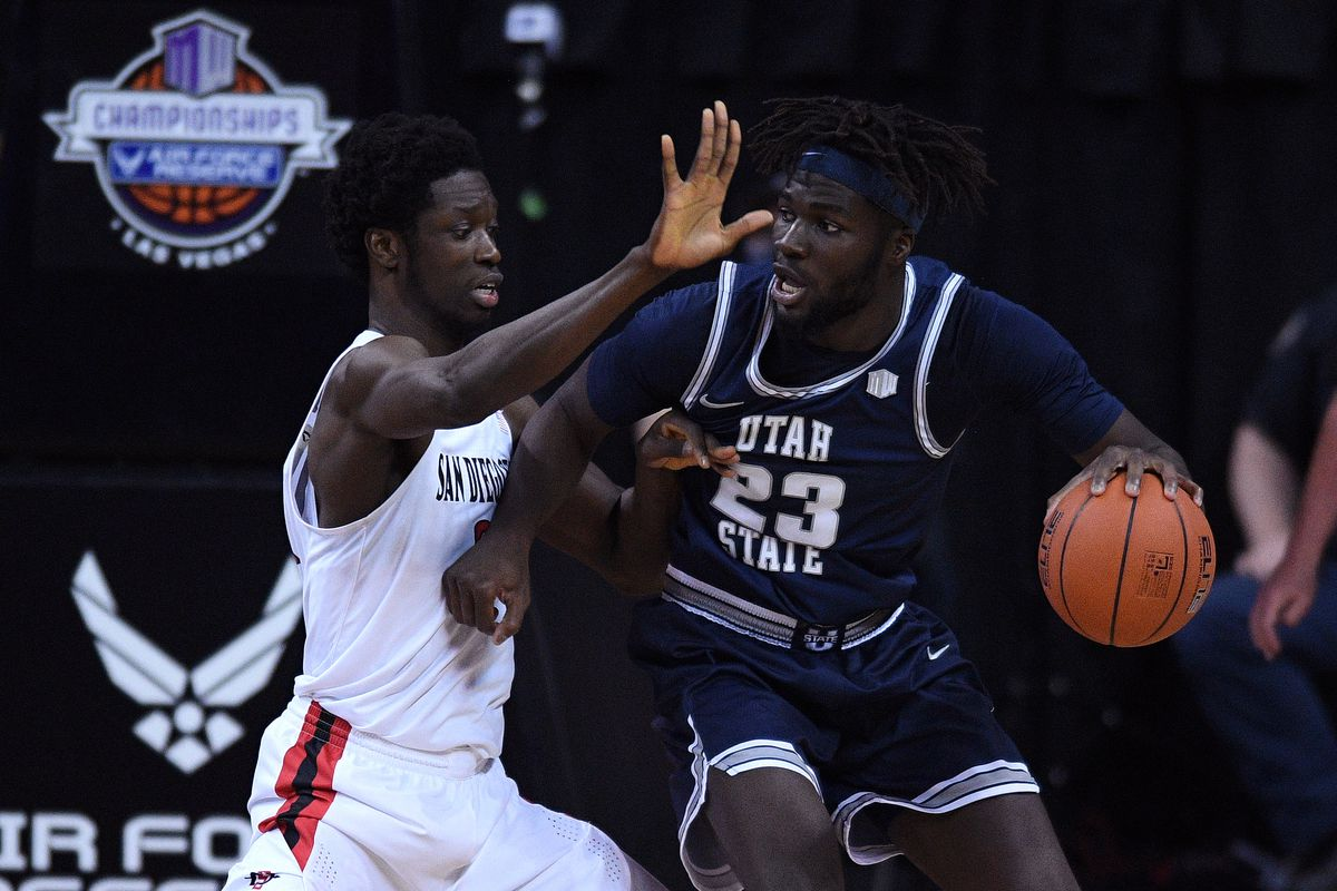 Utah State Aggies center Neemias Queta dribbles the ball while defended by San Diego State Aztecs forward Nathan Mensah during the second half at the Thomas & Mack Center.
