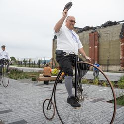 Paul Schmidt, right, and Jim Stulga, left, ride vintage bicycles around the Pullman National Monument on its opening day in the Pullman neighborhood, Saturday afternoon, Sept. 4, 2021.