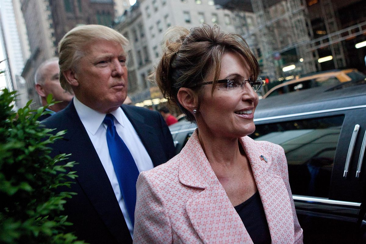 Former US Vice presidential candidate and Alaska Governor Sarah Palin (R), and Donald Trump walk towards a limo after leaving Trump Tower, at 56th Street and Fifth Avenue, on May 31, 2011, in New York City.