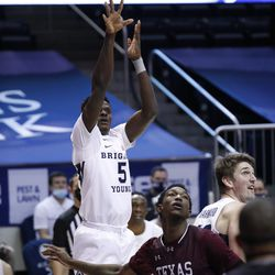 BYU forward Gideon George (5) puts up a shot as Texas Southern forward Joirdon Karl Nicholas (5) looks on during the Cougars' 87-71 victory at the Marriott Center in Provo on Monday, Dec. 21, 2020.