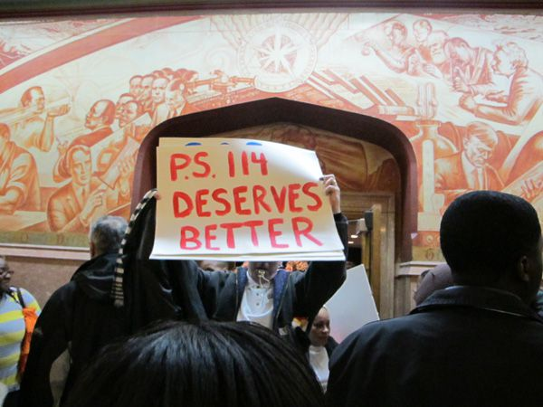 Teachers and parents from Canarsie's P.S. 114 carried signs at a Panel for Educational Policy meeting where the board was set to vote on the school's closure.