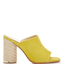 Mules are the runaway hit of the season, as spring shoes are concerned. This style, by Spanish heritage brand Paloma Barcelo, softens the strong lines of the silhouette by pairing yellow suede with an espadrille-inspired heel.