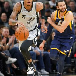 San Antonio Spurs' Dejounte Murray (5) runs up court after taking possession from Utah Jazz' Ricky Rubio during the first half of an NBA basketball game, Saturday, Feb. 3, 2018, in San Antonio. (AP Photo/Darren Abate)