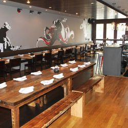 Communal tables and murals of farm animals co-mingle