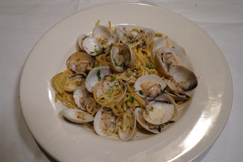 Linguine con Vongole (linguine with whole Manila clams in a white sauce), part ofthe Feast of the Seven Fishes at Italian Village, now officially known as The Village.