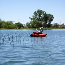 A lone angler casts into the reeds at Pelican Lake in hopes of hooking a bluegill or largemouth bass in June. Fish populations wiped out by winter kill are increasing again.