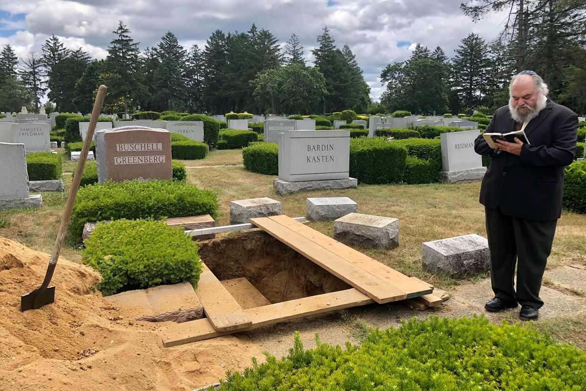 Rabbi Moses Birnbaum of the Jewish Center of Kew Gardens Hills presides over the second burial of Dorothea Buschell, near her parents and sister, on June 30, 2020.