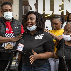 Latoya Smith, sister of Verndell Smith, speaks to reporters at Ultimate Threat Dance Organization's studio, Thursday, May 20, 2021. Verndell, the founder of the dance studio was shot and killed yesterday.