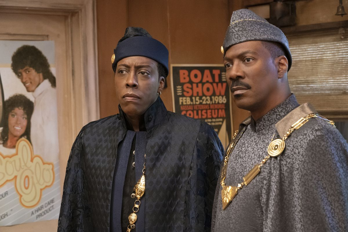 """Arsenio Hall and Eddie Murphy appear in a scene from """"Coming 2 America."""""""