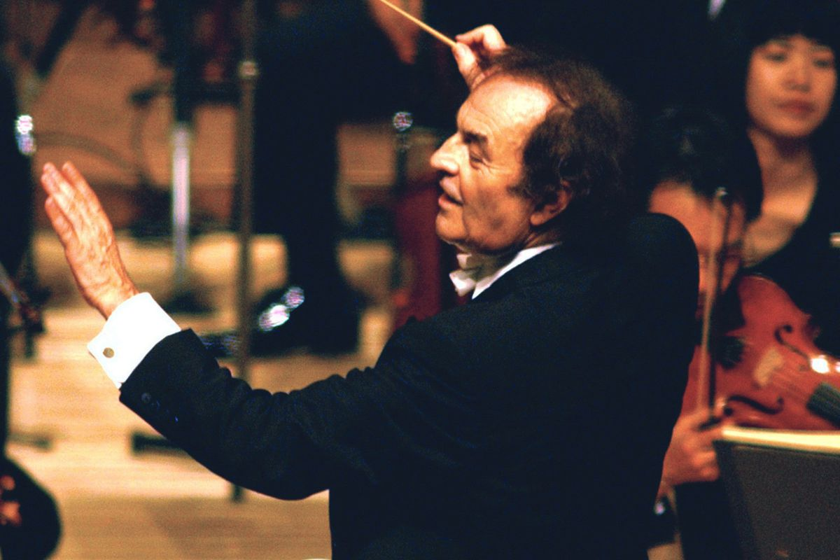 FILE - In this June 19, 2003 file photo, conductor Charles Dutoit performs with NHK Symphony Orchestra in Tokyo, Japan. Four women have accused Dutoit of sexual misconduct that allegedly occurred on the sidelines of rehearsals or performances with some of