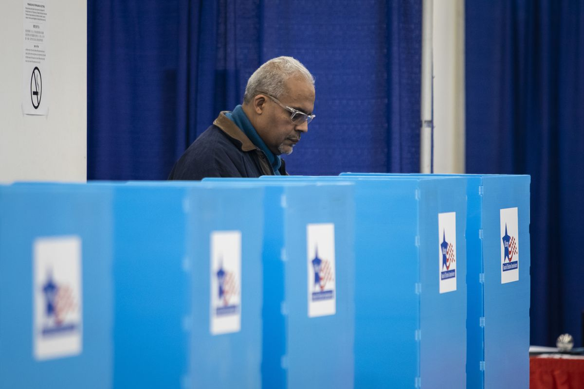 On the first day of early voting, Edwin Reyes, 62, of Beverly, casts his ballot in the March 17 Illinois primary election at the new Loop super site at 191 N. Clark St., Monday morning, March 2, 2020.