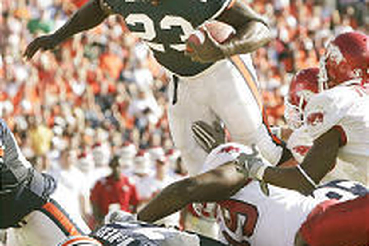 Auburn's Ronnie Brown dives over the pile for a one-yard touchdown against Arkansas during Saturday's game at Jordan-Hare Stadium.