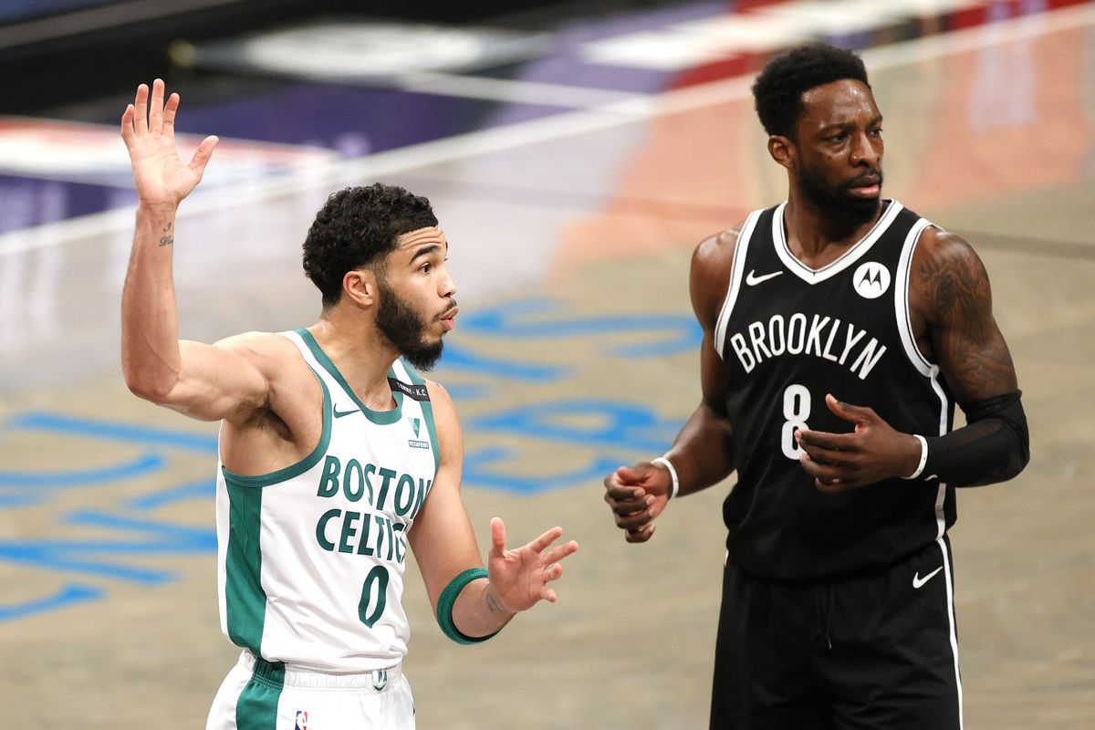Jayson Tatum of the Boston Celtics and Jeff Green of the Brooklyn Nets react to a call during the first half at Barclays Center on April 23, 2021 in the Brooklyn borough of New York City.