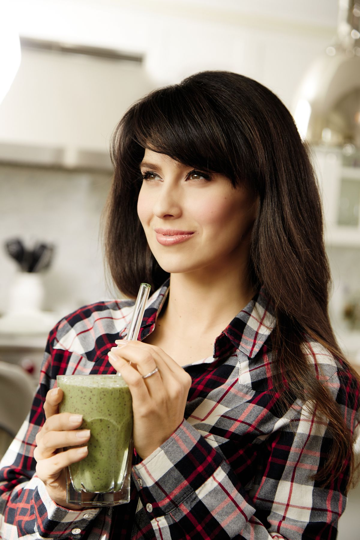 """Hilaria Baldwin enjoys a kale, blueberry, mango and almond butter smoothie, created from one of the recipes featured in her new book """"The Living Clearly Method: 5 Principles for a Fit Body, Healthy Mind & Joyful Life."""" 
