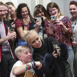 Actress Kristin Chenoweth poses for a selfie with Keeley Milner, who was celebrating her 12th birthday, as she sings during the Encircle SLC weekly music night in Salt Lake City on Thursday, Oct. 17, 2019.Encircle provides programs and other services for LGBTQ individuals to find information and support.