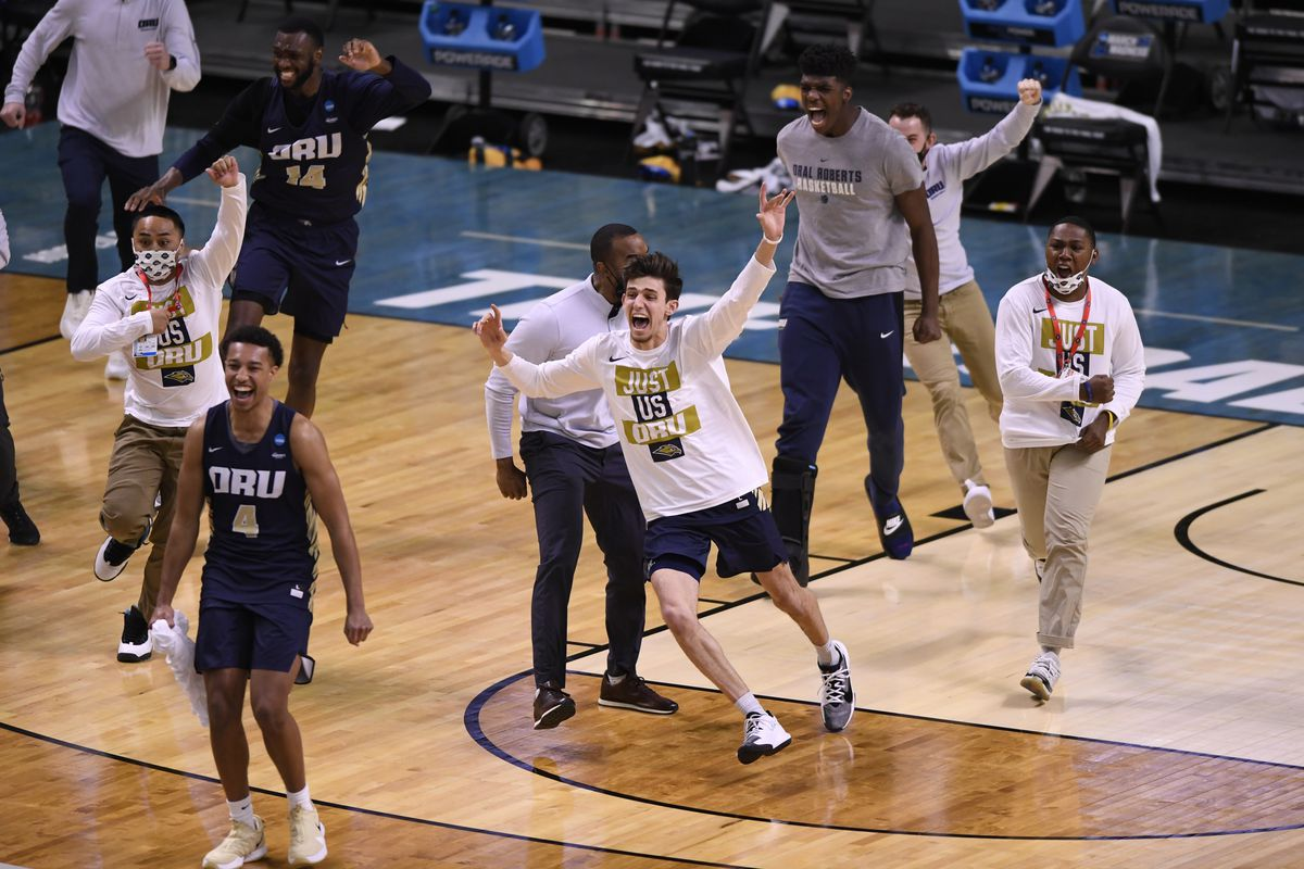 Oral Roberts Golden Eagles bench storm the court after defeating the Florida Gators at Indiana Farmers Coliseum.