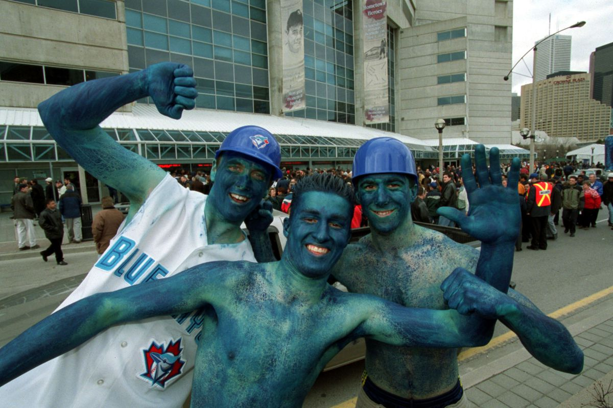 Baseball opens 04/04/02 Opening day Fans at Skydome . Painted fans Shane Delaney , Daniel Janeiro an