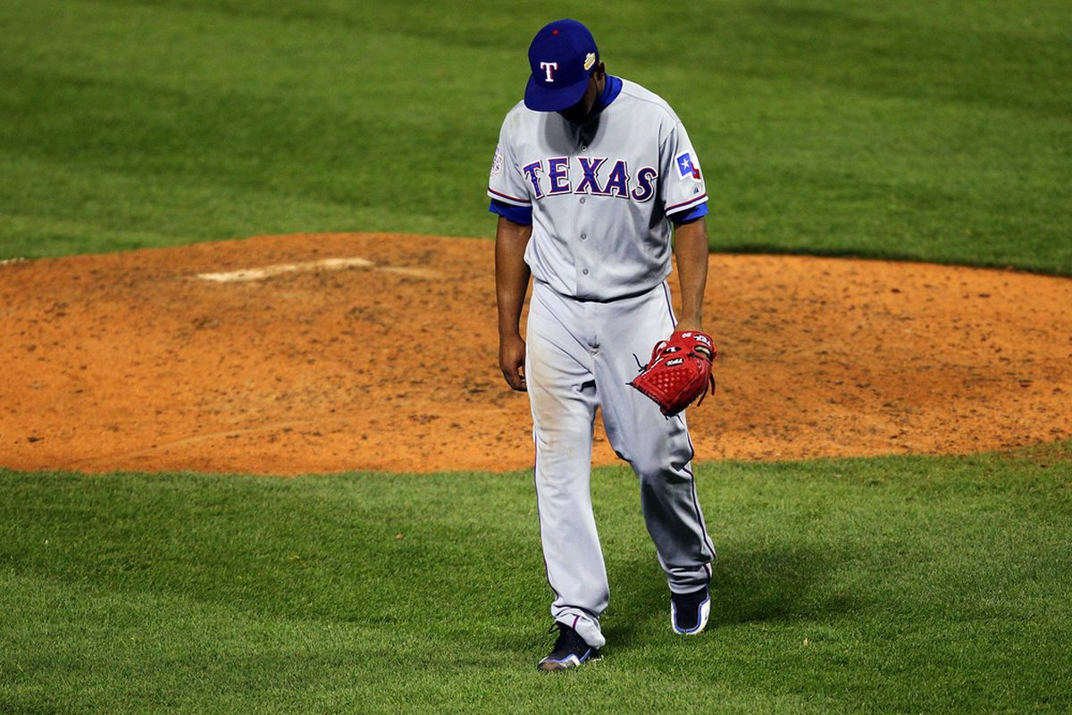 Neftali Feliz doing his sad Charlie Brown walk off of the mound following a blown save that inevitably allowed the Cardinals to take Game 6 and force tonight's Game 7.