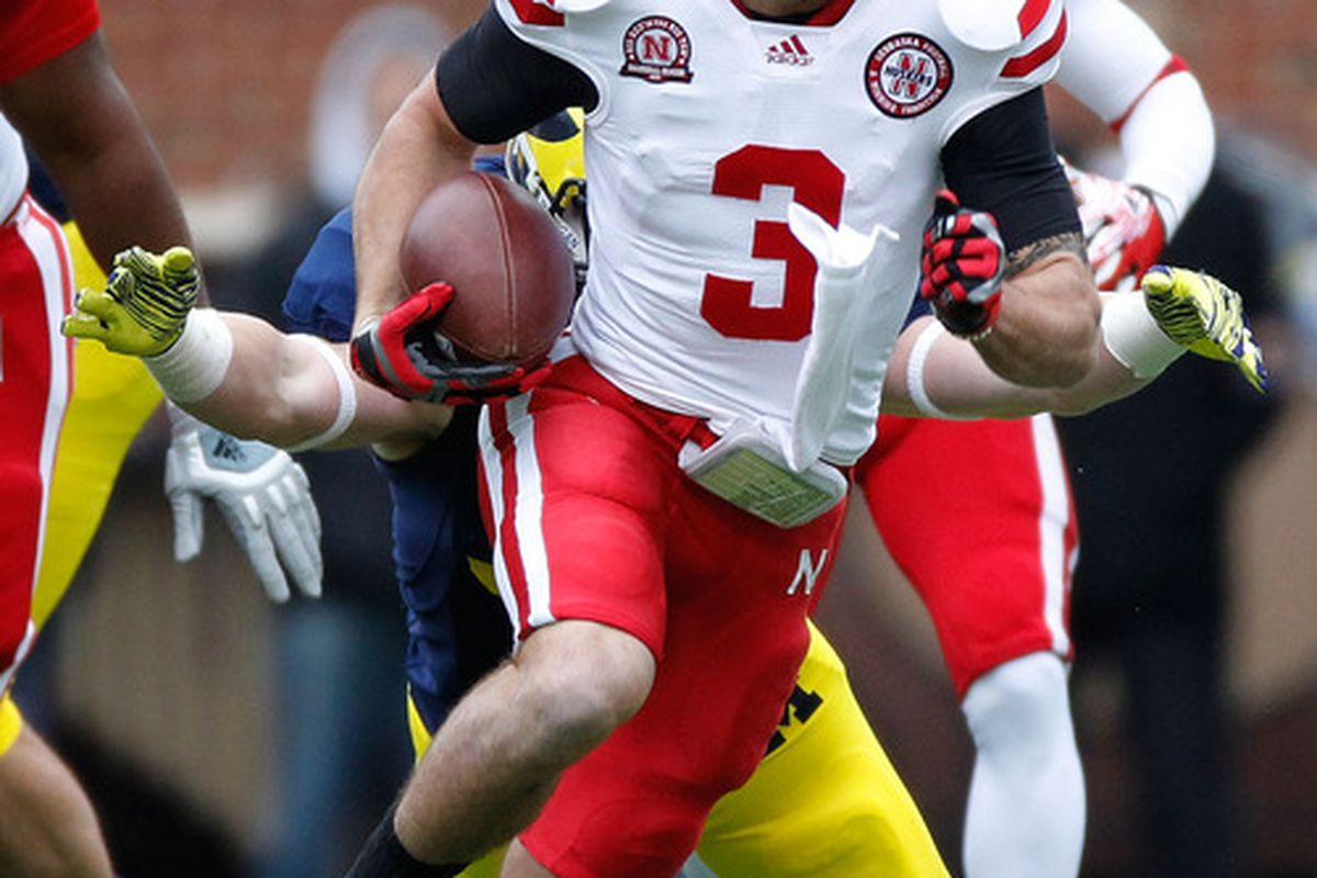Like it or not, Taylor Martinez is Nebraska's quarterback barrying injury.. (Photo by Gregory Shamus/Getty Images)
