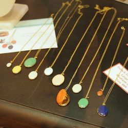 "Trois Petits Points Paris <a href=""http://www.scarlettalley.com/catalog/CategoryDisplay.cfm?cat=14639&cid=396"">Gold Enameled Lockets</a>, $89-$119 at Scarlett Alley."
