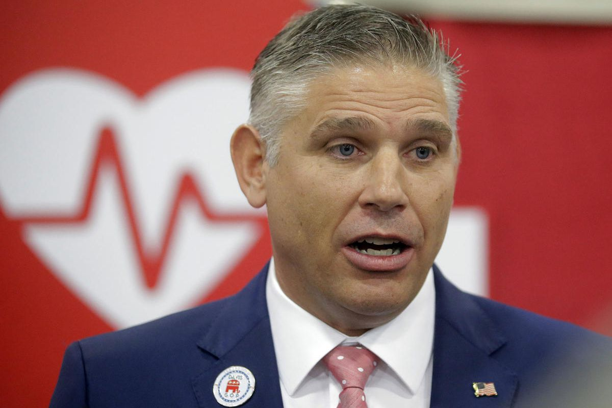 In this May 20, 2017, file photo, Utah GOP chairman Rob Anderson speaks during the Utah GOP Convention in Sandy, Utah. Anderson was elected as the new chairman of the Utah Republican Party. The party is dropping its lawsuit against the state over the cont