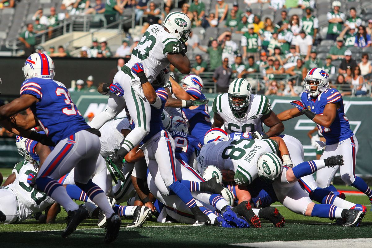 Sept 9, 2012; East Rutherford, NJ, USA; New York Jets running back Shonn Greene (23) leaps for a touchdown during the second half at MetLife Stadium. The Jets defeated the Bills 48-28.  Mandatory Credit: Ed Mulholland-US PRESSWIRE