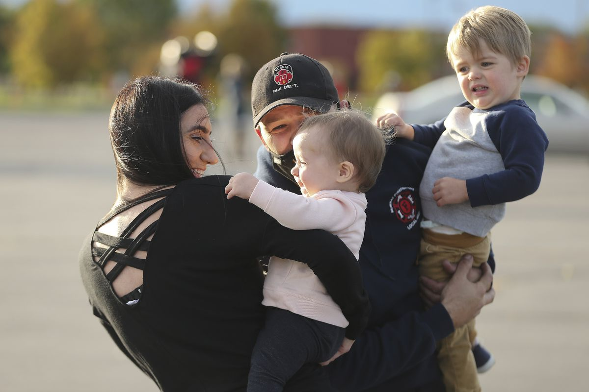 Murray firefighter Cameron Willden hugs his wife, Brittany, and children Nayson and Sloan goodbye as 41 firefighters from various Utah fire agencies gather in West Valley City on Wednesday, Sept. 9, 2020, before deploying to California to help in firefighting efforts there.