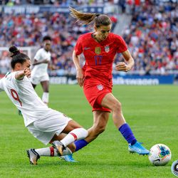September 3, 2019 - Saint Paul, Minnesota, United States - Portugal forward Ana Borges (9) goes in with a slide tackle on USA forward Tobin Heath (17) during the USA World Cup Victory Tour match at Allianz Field.