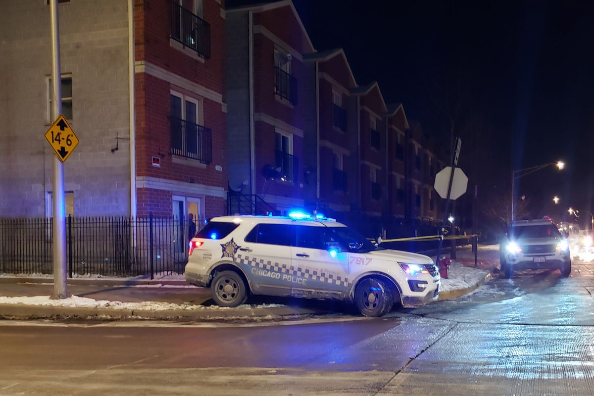 Chicago Police stationed outside the apartment where an 11-year-old boy was shot Feb. 14, 2020.