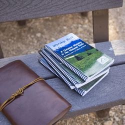 A bible and worship book sit on the bench of the outdoor amphitheater before the 9:30 a.m. nondenominational Christian church service in Bryce Canyon National Park, Sunday, June 18, 2017.