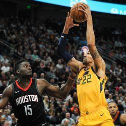 Utah Jazz forward Thabo Sefolosha (22) pulls the ball down in the key as the Utah Jazz host the Houston Rockets at Vivint Smart Home Arena Salt Lake on Thursday, Dec. 7, 2017.