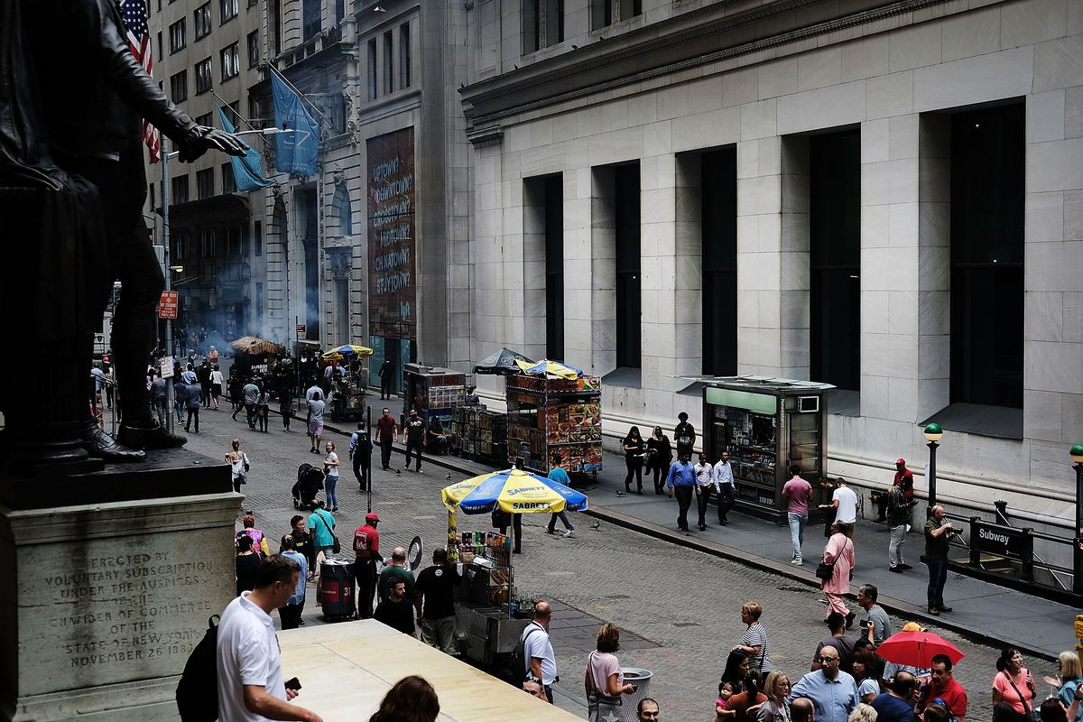 1705cfe4cff429 People walk along Wall Street on the ten year anniversary of the U.S.  financial crisis September 14